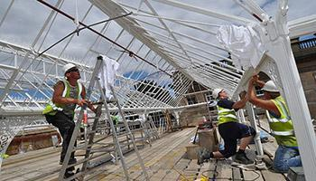 Workers Installing Light in Wentworth Castle Conservatory